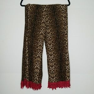 Cheetah print gaucho pants with red crochet hem